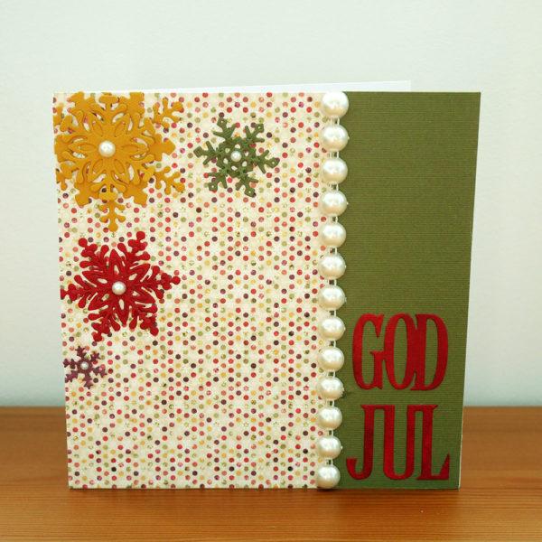 Julkort med pärlor och snöflingor