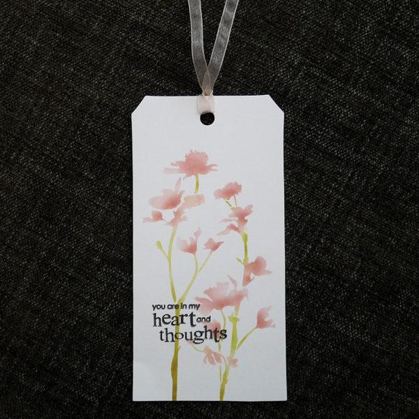 Omtänksam-etikett med blommor