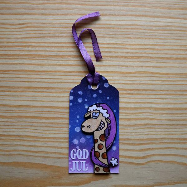 Etikett med giraff som önskar god jul.